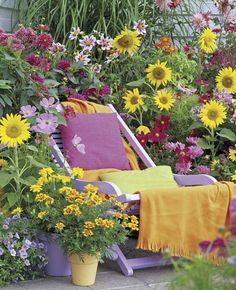 How perfect are those soft lavender & yellow pots with the yellow and lavender flowers (and the chair) - could do this on your patio or deck