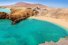 Photo about Lanzarote Papagayo turquoise beach and Ajaches in Canary Islands. Image of relax, rocky, canary - 26598453 Tenerife, Winter Holiday Destinations, Spanish Islands, European Holidays, Paraiso Natural, Secluded Beach, Surfer, Balearic Islands, Canario
