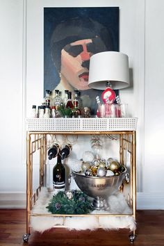 Stylish gold bar cart with marble details and statement art