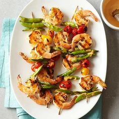 Spicy Shrimp and Sugar Snap Pea Kabobs: Ready in 30 minutes, these kabobs call for shrimp, sugar snap peas and cherry tomatoes brushed with a kicky Sriracha-based sauce.