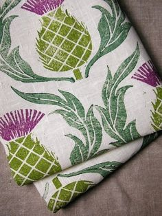 The colorful, hand-stamped thistles on this tea towel spice up natural linen.