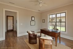For casings, 50 percent is good. Generally, vertical trim elements such as door and window casings should be smaller and have less heft than baseboards. So I've found that a good rule of thumb for sizing window and door casings is to keep them at about 50 percent of the height of the baseboard.