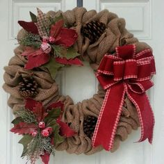 "18"" Burlap wreath Poinsettias and pine cones Red bow Bow ribbon varies by inventory."