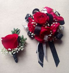 Matching corsage and boutonniere. Red roses, babies breath and accents of black and silver. Prom - Homecoming - formal dance. Floral design by Barbara Colson