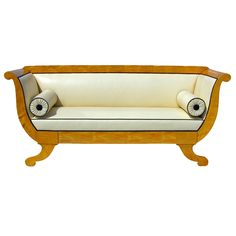 Biedermeier Sofa ~ Sofa with veneered 'S' shaped sides terminating in a scroll repeated in the feet.