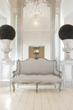 white settee, floorboards, urns and topiary heaven!