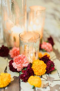 Carnations and candles, awesome ceremony decor idea! | Photography: Mademoiselle Fiona - mademoisellefiona.com  Read More: http://www.stylemepretty.com/2014/05/02/modern-indian-inspired-wedding/