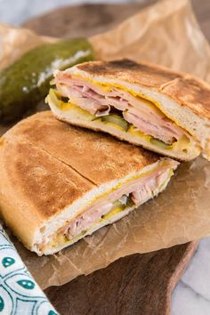 """No one can seem to agree on where and when the Cuban sandwich originated, but most can agree that it's delicious. This humble sandwich is workingman's fare for the cigar makers and sugar cane field workers in Cuba, and among the Cuban communities in Florida. Walk down Calle Ocho in Miami's Little Havana neighborhood, and you'd be hard-pressed to not find a café selling """"sandwich mixto"""" along with little cups of intense Cuban coffees."""
