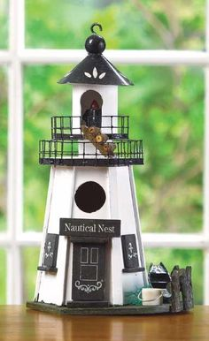 """Lovebirds love this lighthouse! This Nautical Nest Lighthouse Theme Birdhouse features two-tiered walkways and authentic accents to perk up this Pennsylvania Dutch style haven. - Wood. - 7 1/4"""" x 5 1/                                                                                                                                                     More"""