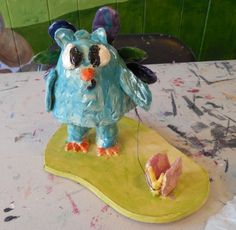 Awesome surrealist inspired ceramic sculpture of a peacock walking a butterfly on a leash from Engage Art Studio - Kids & Adult Art Classes & Workshops near Blue Bell, PA