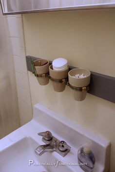 Awesome small bathroom storage idea: mount mason jars, cups, or tiny flower pots to the wall to store small toiletries!