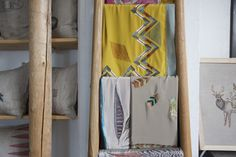 Worldly textiles styled on wood ladder // Coral & Tusk Studio Tour