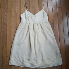 Forever 21 Swiss Dot Dress Creamy/ light yellow dress with swiss dot detail from Forever 21. Size small, fits like a XS (0-2). Lined! Side zipper. Lace up detail on back. Pairs adorably with cowboy boots or wedges. No holes or tears, great used condition. Forever 21 Dresses