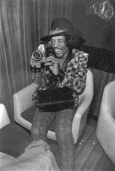 Jimi Hendrix shooting his Canon super 8 camera, 1968 -- photo by Elliott Landy.