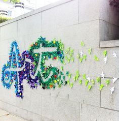 "A few days ago colorful origami street art sprouted on the walls of the Asian Art Museum in San Francisco. Outlined with hundreds of folded paper pieces, the stylized word ""Art"" captivated passer-byes. The typographic street art was created. Group Art Projects, Collaborative Art Projects, School Art Projects, 3d Origami Stern, Art Classroom Decor, Art Bulletin Boards, Street Art, School Murals, Asian Art Museum"
