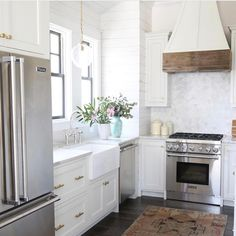 A shot from our post on @oldseagrovehomes amazing kitchens from earlier this week -- more details on the blog! White coastal kitchen with shiplap and natural wood.