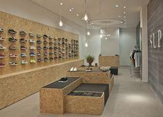 Ruwe materialen voor SUPPA Sneaker Boutique. Meer foto's, zie http://www.dezeen.com/2012/08/11/suppa-sneaker-boutique-by-daniele-luciano-ferrazzano/