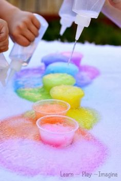 Make beautiful rainbow eruptions with baking soda and vinegar - exciting for kids and grown ups alike!