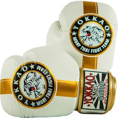 See our Official Fight Team gloves in white and gold. Made with triple density foam for unparalleled impact distribution. Muay Thai Gloves, Martial Arts Equipment, Muay Thai Training, Kickboxing Gloves, White Gold, Martial Arts Gear
