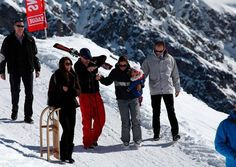 1 March 2013     This morning William, Kate, and Harry travelled to the mountains of Grabunden with their friends Harry and Rosie Meade (with their adorable baby) for some skiing before the wedding of the Princes' polo friend Mark Tomlinson and Olympian Laura Bechtolsheimer tomorrow. The boys have played polo together for years, and Prince Charles is close with his parents, Simon and Claire, who own the Beaufort Club near Prince Charles's Highgrove estate.