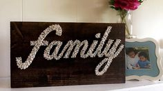 family String art are custom orders. you can customize this according to color of stained wood, size, string color etc...