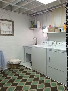 Unfinished laundry room. Painted white. Added a rug, curtains to hide the furnace and a few accents.... Now I feel ok doing laundry in here!!