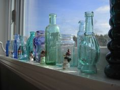 I had to choose one of the seven elements to focus on for this project. I chose line and chose these bottles in a row on the window. I brightened the picture using the brightness tool and stamped out a flag in the background.