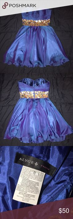 Blue strapless Alyce homecoming/prom dress. Beautiful blue and silver dress, it has never been worn. Alyce Paris Dresses Strapless