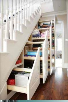Storage under the stairs - wow what a great idea!