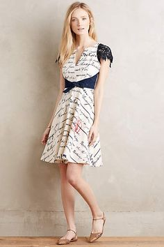 Chirography Dress. Very French. Like the lace sleeves and the fit and flare style.