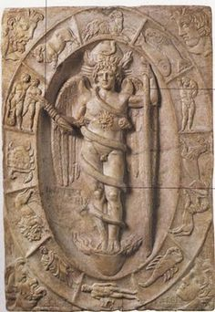 Phanes- primeval god of creation and procreation entwined with a serpent inside the cosmic egg