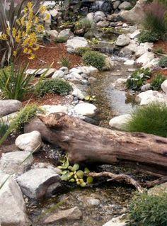 "A driftwood ""bridge"" makes this waterfall and stream spectacular Backyard Stream, Backyard Water Feature, Ponds Backyard, Pond Landscaping, Landscaping With Rocks, Water Pond, Water Garden, Landscape Design, Garden Design"
