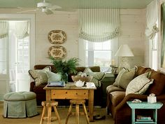 This coastal living room pulls the color scheme into every piece -- love it!