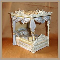 Pure silk upholstered Dollhouse Four Poster Bed.