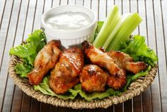 Healthier Hot Wings - Here, boneless skinless chicken is coated in hot sauce and dredged in breadcrumbs for a tasty game-night appetizer.