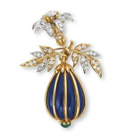 A DIAMOND, EMERALD AND ENAMEL BROOCH, BY JEAN SCHLUMBERGER, TIFFANY & CO. Designed as a blue enameled eggplant accented at the bottom tip by a cabochon emerald, the stem intertwined with the scrolling vines of the brilliant-cut diamond floral spray, mounted in 18k white and yellow gold, 5.9 cm long, in navy blue suede Tiffany & Co. case Signed Tiffany & Co., Schlumberger
