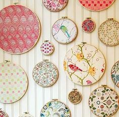 Turn your fabric scraps into art.  I've decided I must have a wall like this in my house, it screams happiness :)