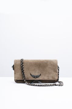 "Zadig & Voltaire zip clutch, two removable metal chains interlaced with suede leather, can be worn crossbody or on the shoulder, large rhinestone wings rivet, 3 cm/1.25"" D, 18 cm/7"" H, 27 cm/10.75"" L, 100% leather."