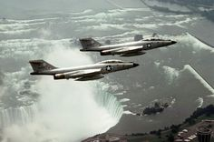 Two F-101 Voodoos of the New York Air National Guard fly patrol over Niagara Falls. Beautiful pic.