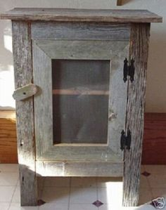 """Old Barn Wood Cabinet. This Simple, Yet Striking Piece of Old Barn Wood Furniture Will Look Great in a Country Kitchen Decor or Any Room in Your Home. The Barnwood Cabinet Was Crafted Out of Reclaimed Barn Wood Salvaged From an Old Ohio Barn That Has Withstood Nature's Elements for Over a Century. An Ideal Collectible That Is Destined to Become an Heirloom. A Very Unique Gift Idea. This Barnwood Cabinet Measures Approx 18"""" X 9"""" X 29"""" with a Screened Front. Colors May Vary. -"""