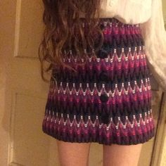 Free People Knit Mini Skirt Free People for Urban Outfitters petite size small S/P pink, purple, cream, and teal striped highwaisted knit mini skirt with buttons down the front, elastic waistband, zig zag lines, and in excellent condition. Free People Skirts Mini