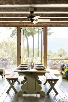 Screened Porch  ceiling alternates between painted wood and stained beams