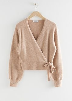 And other stories Wrap Cardigan Long sleeve soft knit wrap cardigan with a long ribbed hemline. Length of cardigan: / (size S) Model wears: S