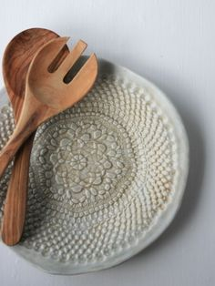 Dish and wooden tongs