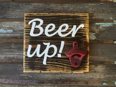 Rustic pallet wood sign - Beer up! Distressed black background with white lettering and vintage red bottle opener. Add a six pack for a unique pick me up gift!