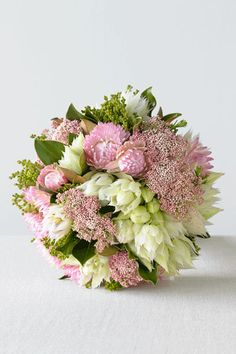 Clustered posy of paper daisy, blushing bride and mixed buds. Available in autumn and winter from Rococo Flowers.