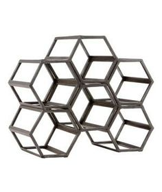 Black Hexagonal Wine Rack: Stow your vino within this maze of geometric and industrial construction.