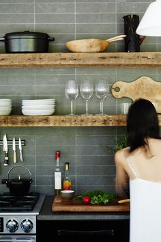 stone subway tile and reclaimed wood open shelving