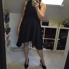 H&M black dress H&M knee-length, sleeveless dress in woven fabric with a sheen. Flared, asymmetric skirt. Small opening at back of neck with button. 100% polyester. Machine wash warm. Imported H&M Dresses Asymmetrical