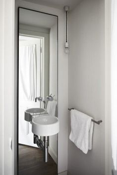 Small Bathroom Solution: Mirrored Walls Inspiration & Ideas   Apartment Therapy - how do you keep the water from ending up ruining the mirror?